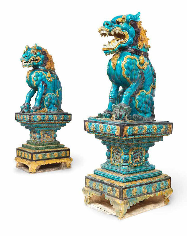 A very rare pair of monumental fahua Buddhist lions on stands, Late Ming Dynasty, 16th-17th century