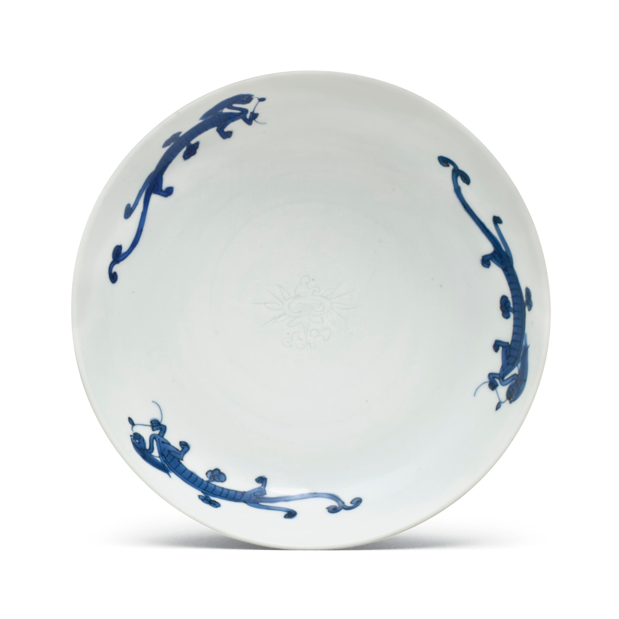 A blue and white anhua-decorated dish, Longqing four-character mark in underglaze blue and of the period (1567-1572)