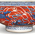 An iron-red and underglaze-blue 'mythical beast' bowl, qianlong seal mark and period (1736-1795)