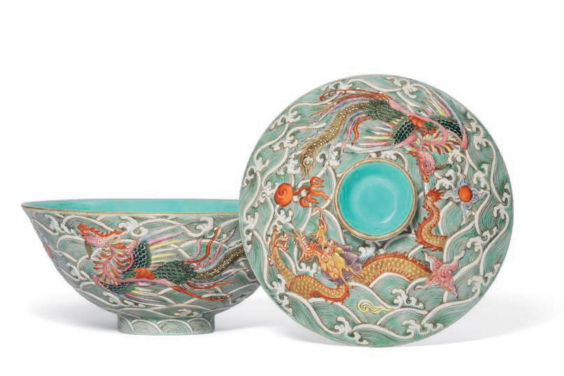 A moulded famille rose 'dragon and phoenix' bowl and cover, Qianlong-Jiaqing period (1736-1820)