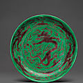 A rare aubergine and green-glazed 'dragon' dish, kangxi six-character mark and of the period (1662-1722)