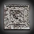 A small bronze square 'lion and grapevine' mirror. tang dynasty (618-907)
