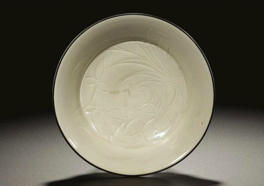 A 'Ding' 'Ducks and Water Plants' dish, Northern Song dynasty (960-1127)