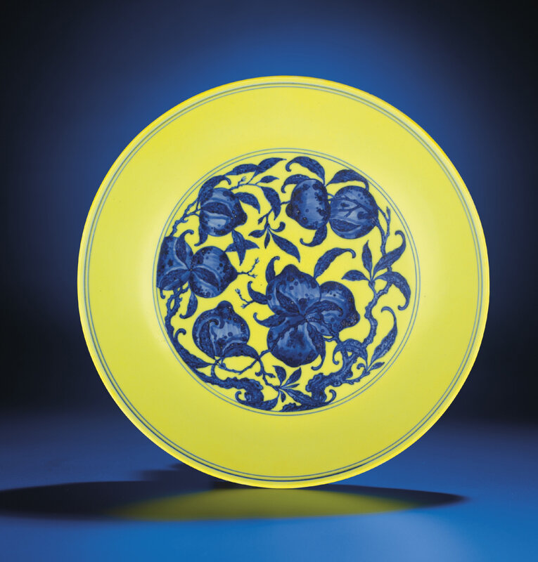A rare large yellow-ground blue and white 'Peach' dish, Qianlong six-character seal mark and of the period (1736-1795)