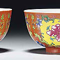 A pair of famille rose coral-ground bowls, guangxu six-character marks in underglaze blue and of the period (1875-1908)