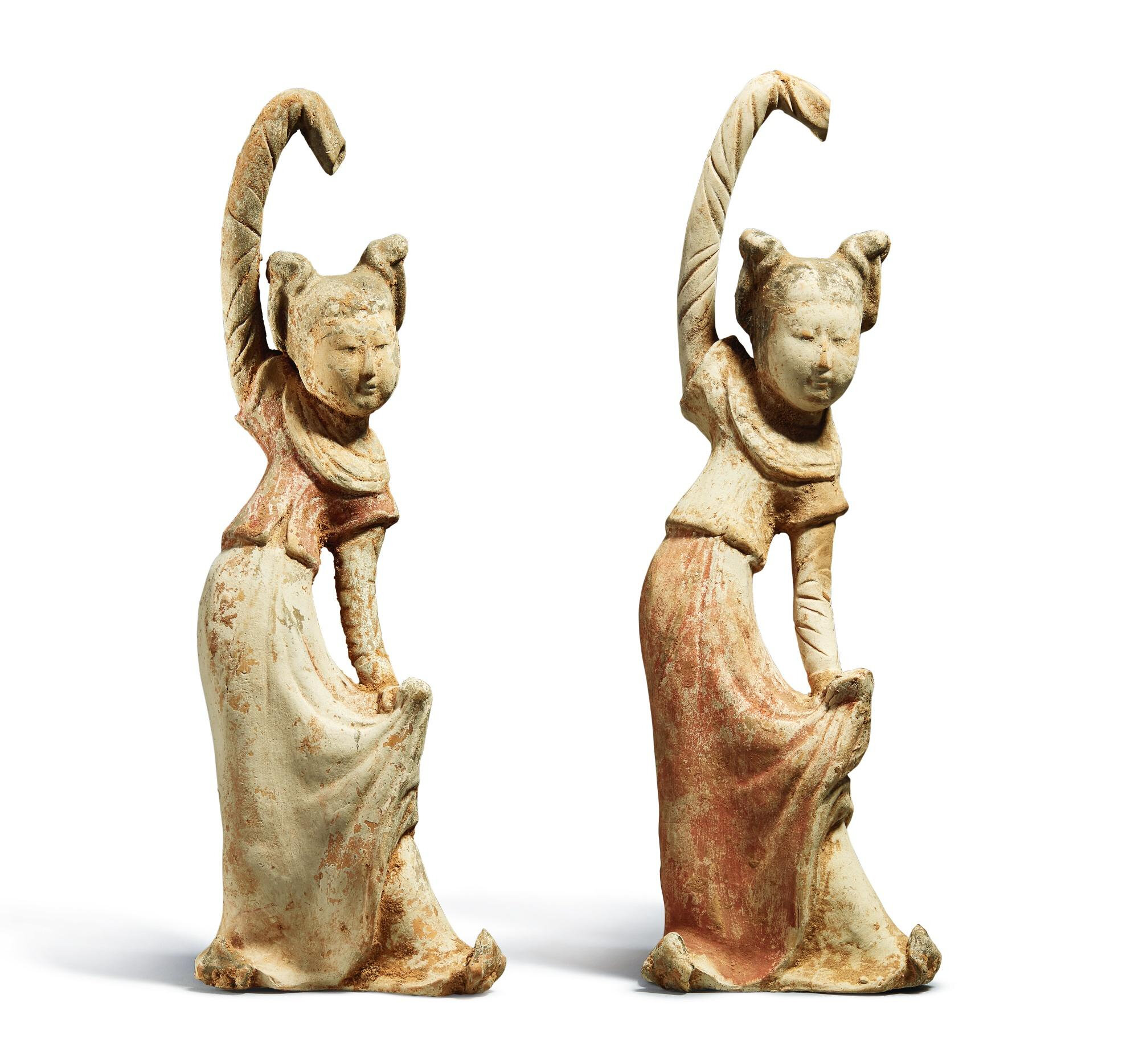 Two painted pottery standing figureS of female dancers, Tang dynasty (618-907)