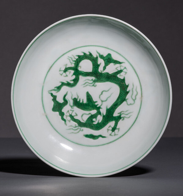 A fine imperial green-enamelled ' dragon' dish, underglaze blue Zhengde six-character mark and of the period (1506-1521)