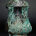 an archaic bronze wine vessel and cover, zhi, early western zhou dynasty