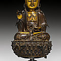 A parcel-gilt bronze figure of a seated bodhisattva, china, 17th century