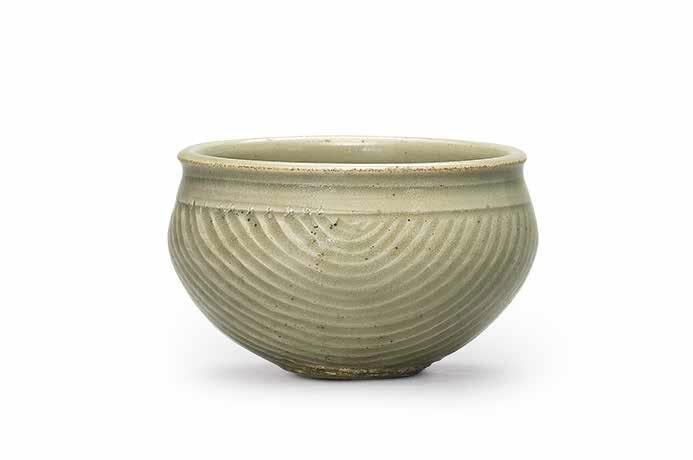 A carved Yaozhou celadon measure, Northern Song dynasty (960-1127)