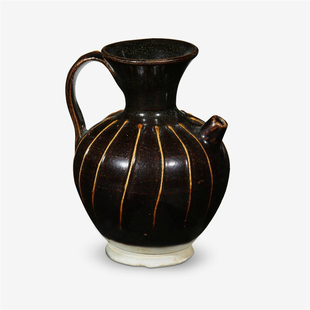 A small Chinese 'cizhou' ribbed black glazed ewer, Jin dynasty (1115–1234)