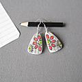 Boucles fleur sur cahier