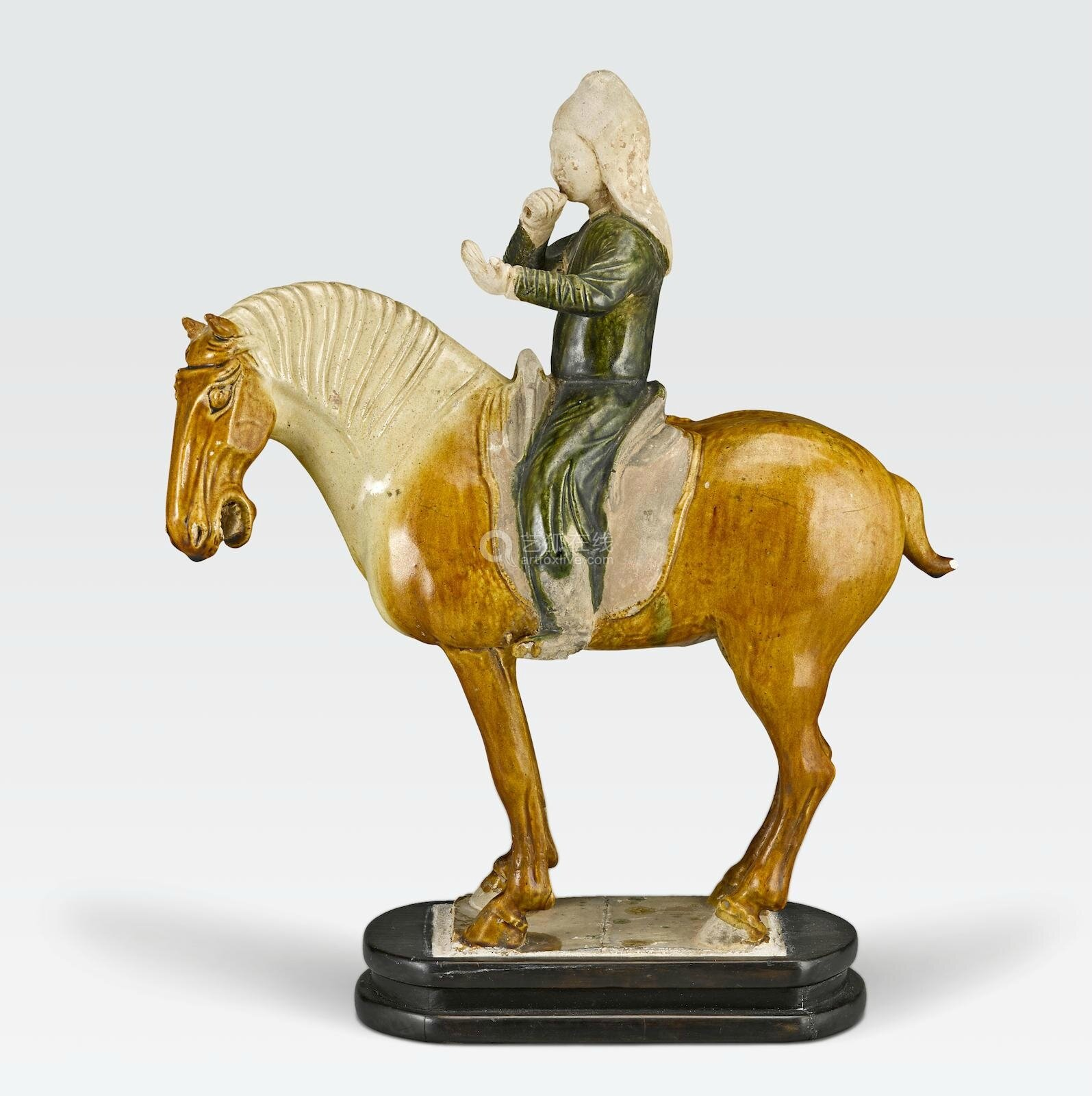 A sancai glazed pottery horse and rider, Tang Dynasty (618–907)