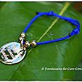 Bracelet nylon roi médaille plaquée or