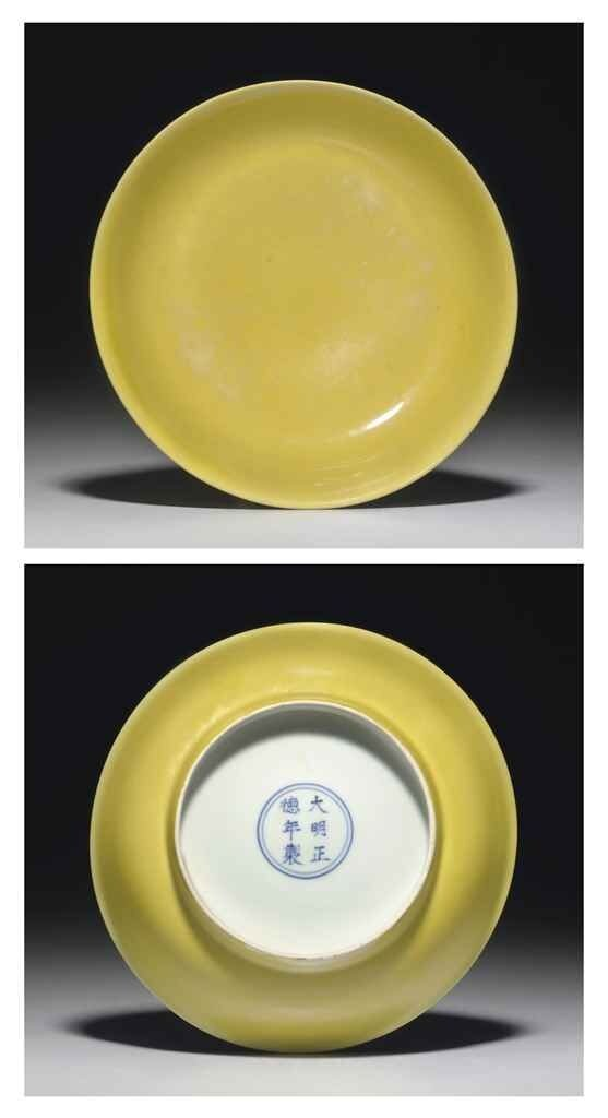 An_Imperial_yellow_glazed_dish__Zhengde_six_character_mark_in_underglaze_blue_within_a_double_circle_and_of_the_period__1506_1521_