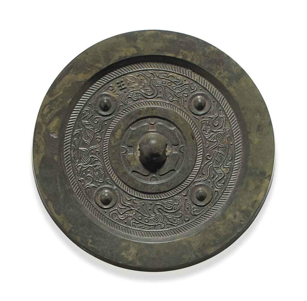 A bronze circular mirror with animals, Western Han dynasty (206 BC-AD 8)