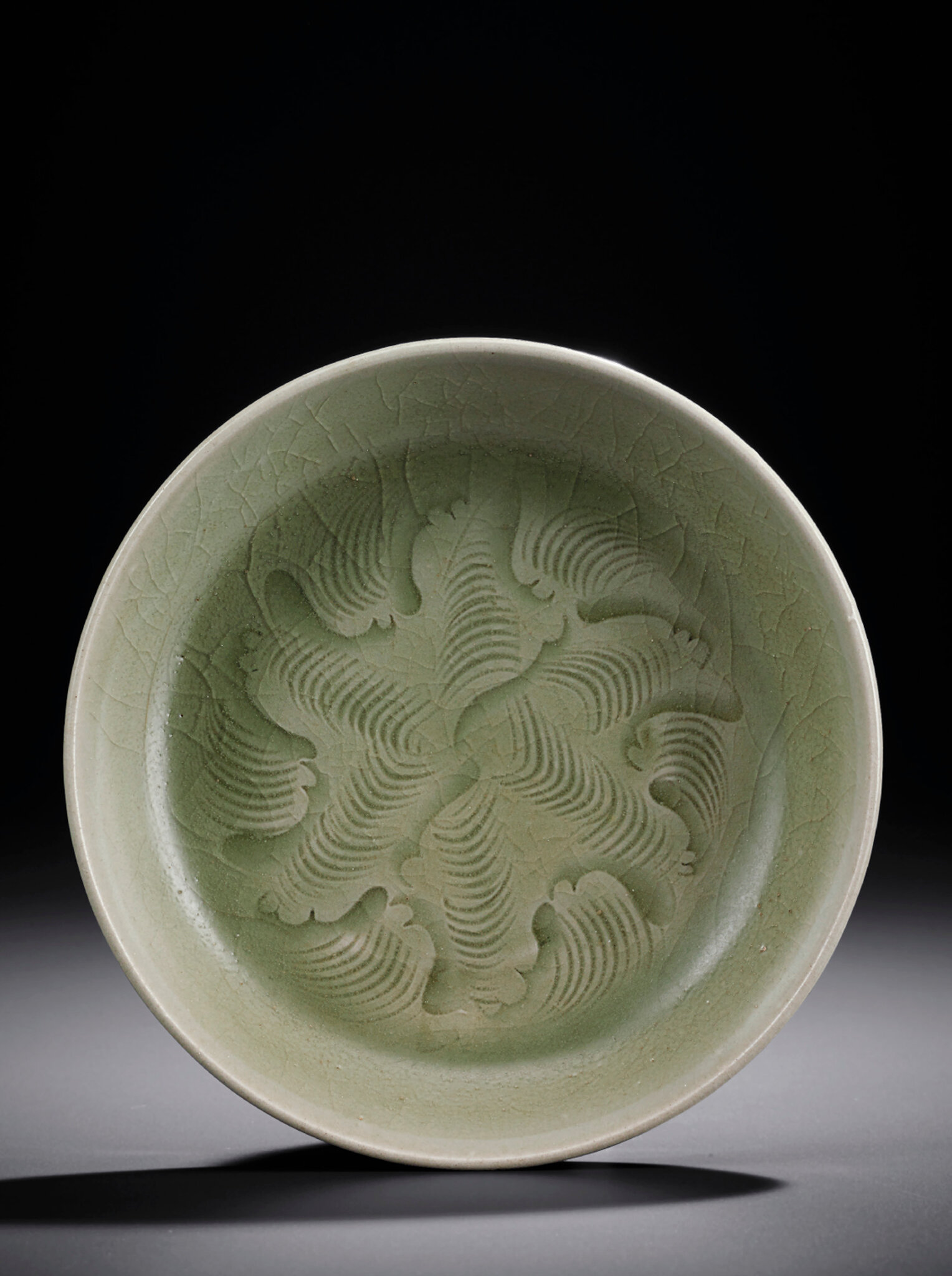 A small Yaozhou celadon carved dish, Northern Song dynasty (960-1127)