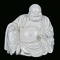 A blanc de chine porcelain sitting budai, china, dehua, qing dynasty, 18th century