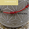 Collier corail rouge avec message secret