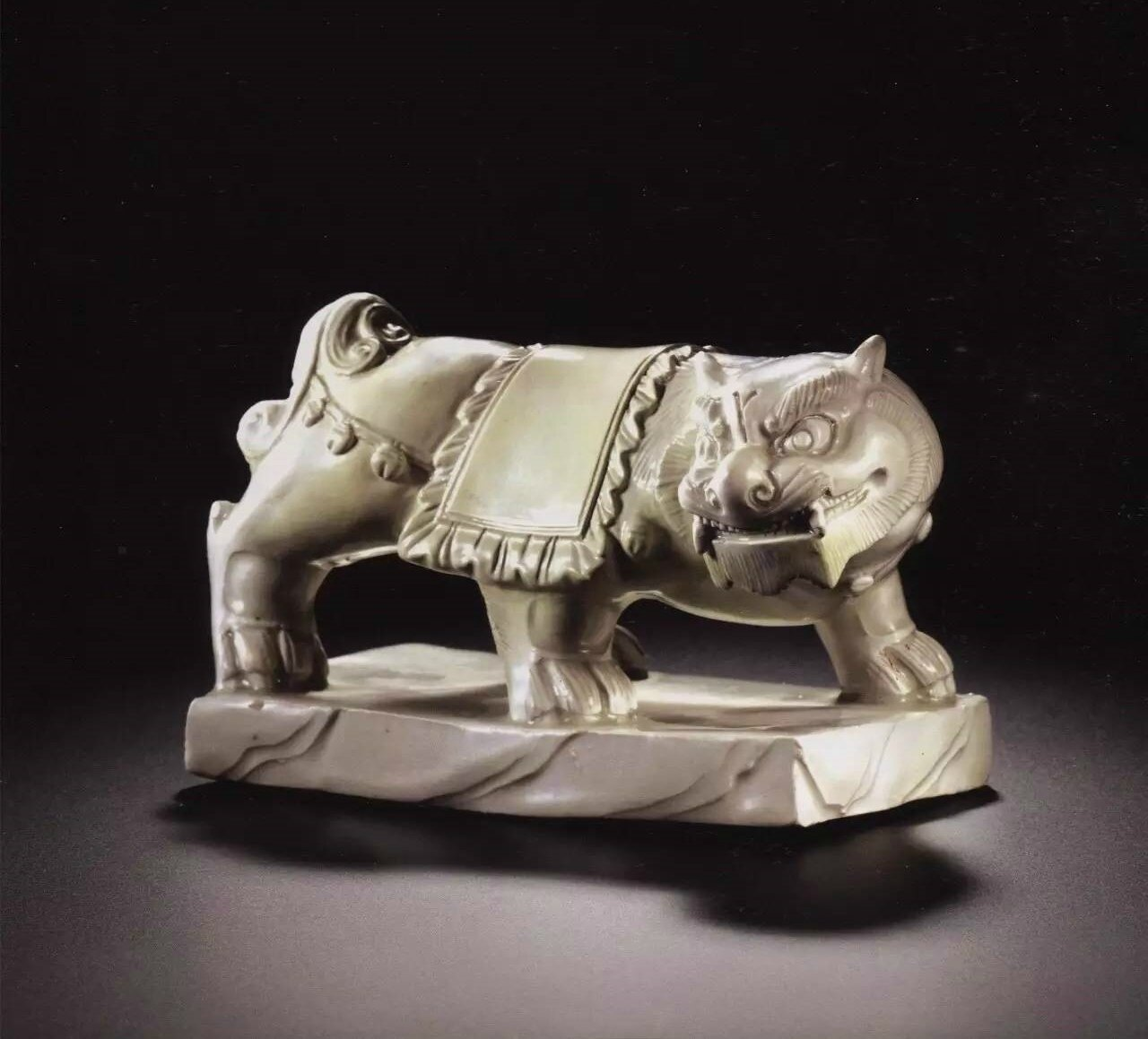 A rare inscribed 'Xing' figure of a lion, 10th century