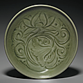 A carved Yaozhou 'Lotus' dish, Northern Song-Jin dynasty, 12th-13th century