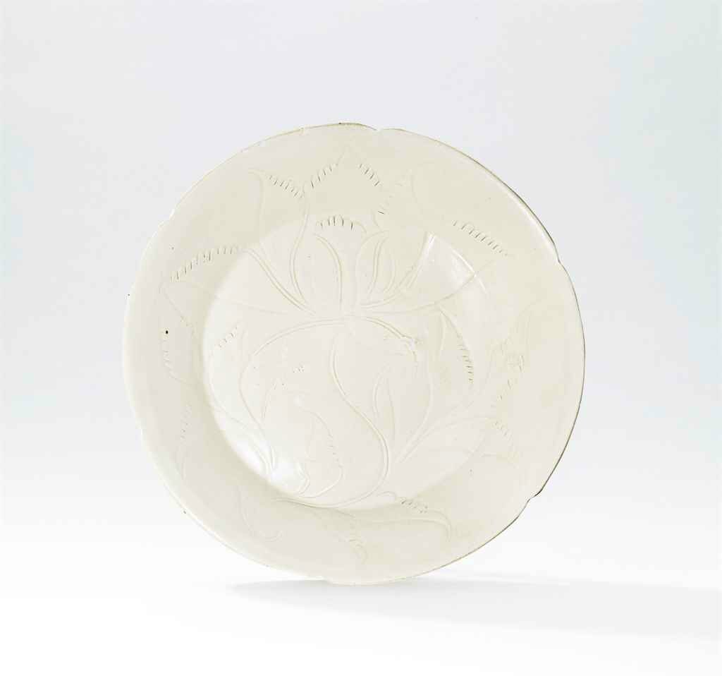 A carved Ding 'lotus' mallow-shaped dish, Northern Song dynasty (960-1127)
