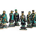 Eight blue and aubergine glazed terracotta figures of immortals, china, qing dynasty (1644-1911)