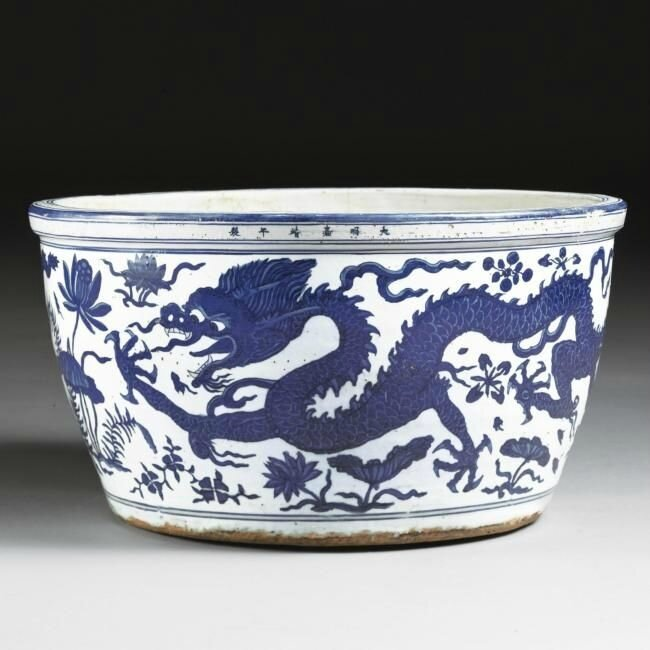 A rare and large blue and white 'water dragon' basin