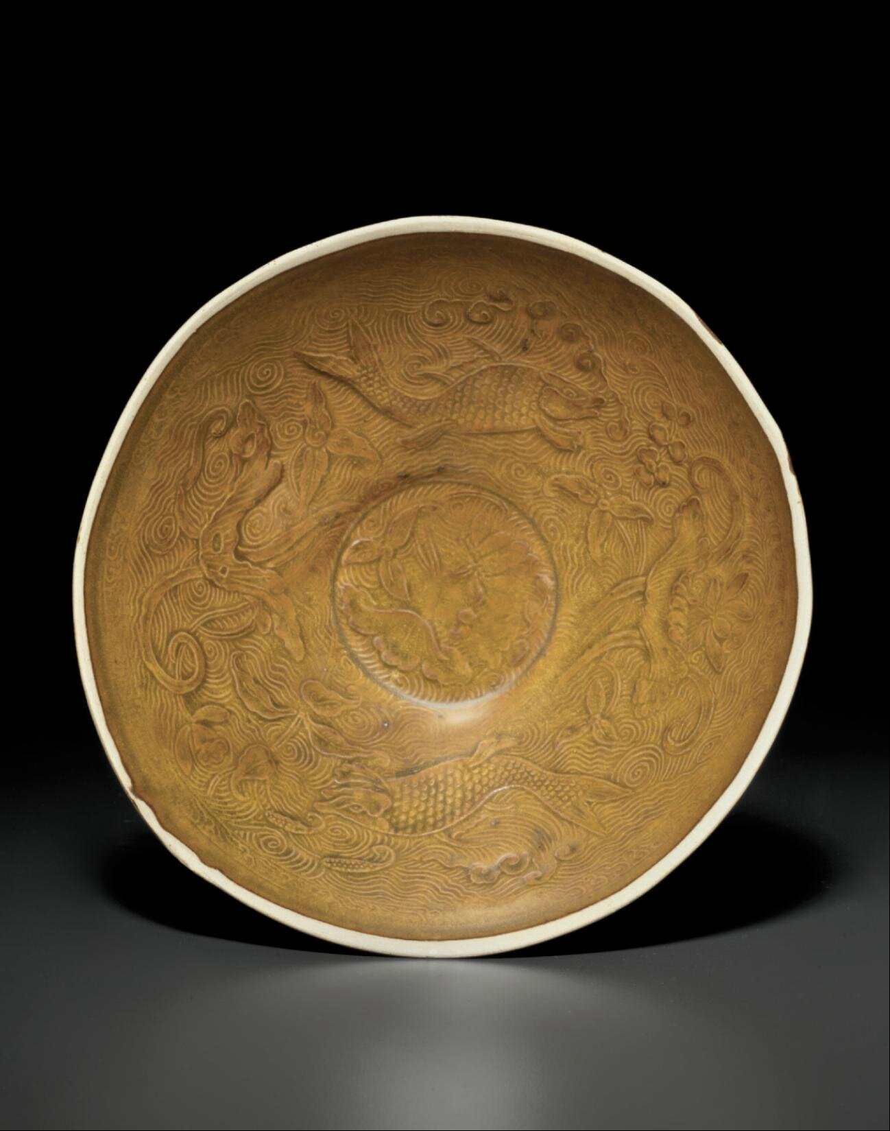A very rare and important brown-glazed Dingyao molded conical bowl, Northern Song dynasty (AD 960-1279)