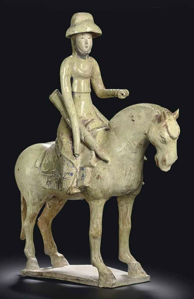 A rare straw-glazed figure of an equestrienne, Tang dynasty (618-907)
