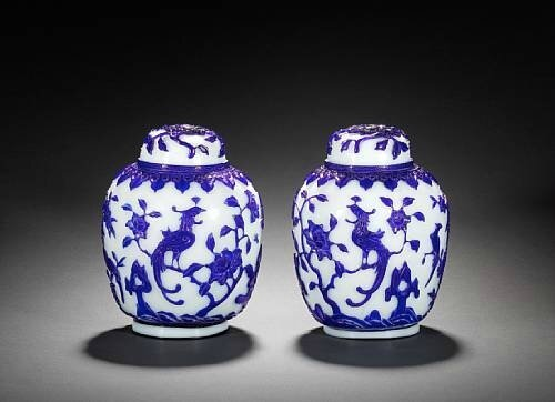 A pair of blue overlay Peking glass oviform vases. 18th/19th century. Photo Bonhams
