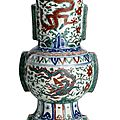 A fine and rare Ming wucai 'dragon' zun-shaped vase, China, Wanli six-character mark within double circles and of the period (1573-1639)