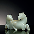 A pale greenish-white and russet jade carving of two horses, qing dynasty (1644-1911)