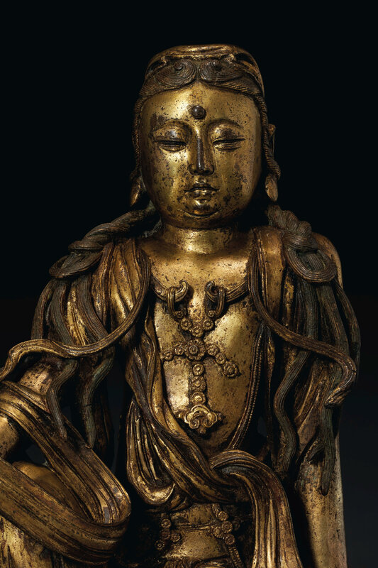 2020_NYR_19038_0810_006(a_very_rare_gilt-bronze_figure_of_white-robed_guanyin_china_ming_dynas020052)