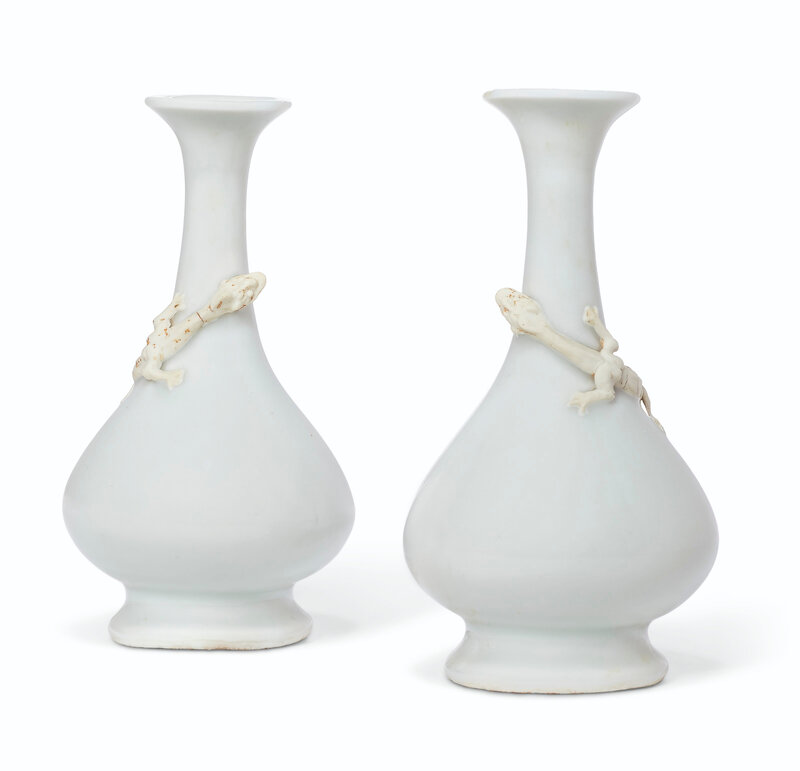 A pair of small biscuit-decorated white-glazed bottle vases, Ming dynasty, 16th-17th century