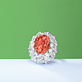A superb padparadscha sapphire and diamond ring
