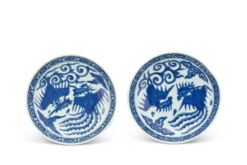 A pair of blue and white 'phoenix' saucer dishes, Marks and period of Wanli (1573-1619)