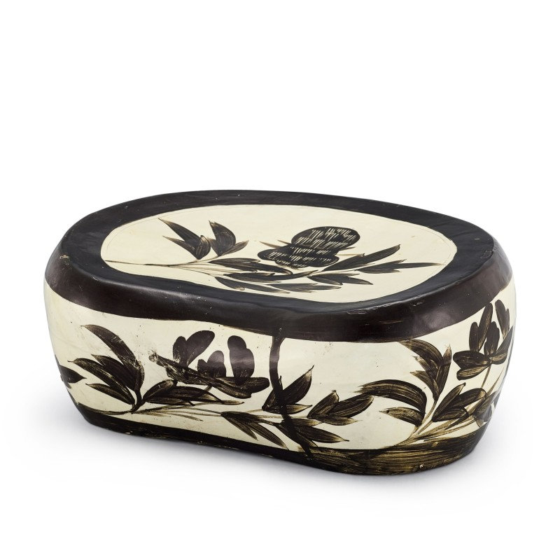 A Shanxi black-painted 'floral' pillow, Northern Song dynasty (960-1126)