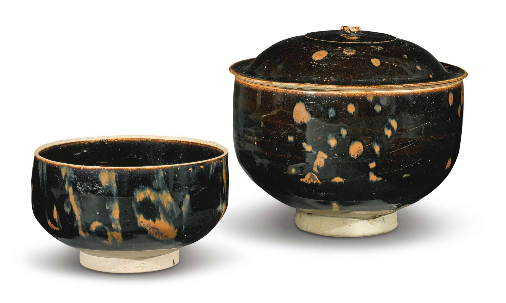 A russet-splashed black-glazed 'partridge-feather' bowl, cover and tea bowl, Jin Dynasty
