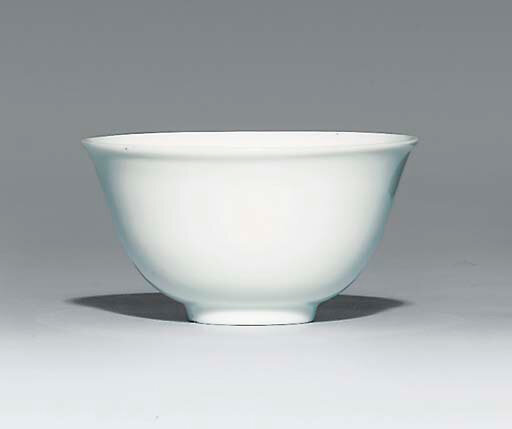 A small white-glazed cup, underglaze-blue Jiajing six-character mark within a double circle and of the period (1522-1566)