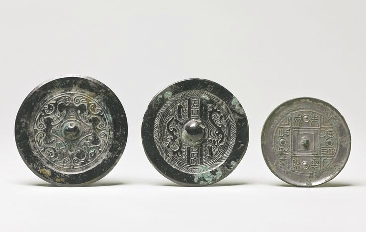 Three bronze mirrors with inscriptions, Han dynasty