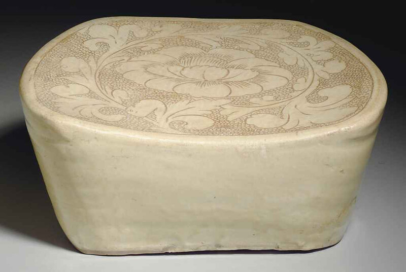 A Cizhou ivory-glazed carved pottery pillow, Song dynasty, 11th-12th century