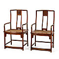 A fine and rare pair of huanghuali continuous yoke back arm chairs, china, qing dynasty