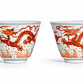 A fine pair of iron-red dragon cups, seal marks and period of qianlong