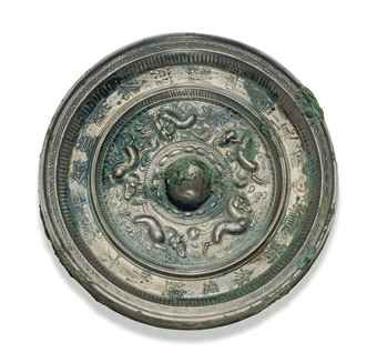 a_silvery_bronze_circular_mirror_with_animals_and_inscription_sui_earl_d5540043h