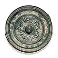 A silvery bronze circular mirror with two animals and inscription. sui-early tang dynasty, 6th-7th century