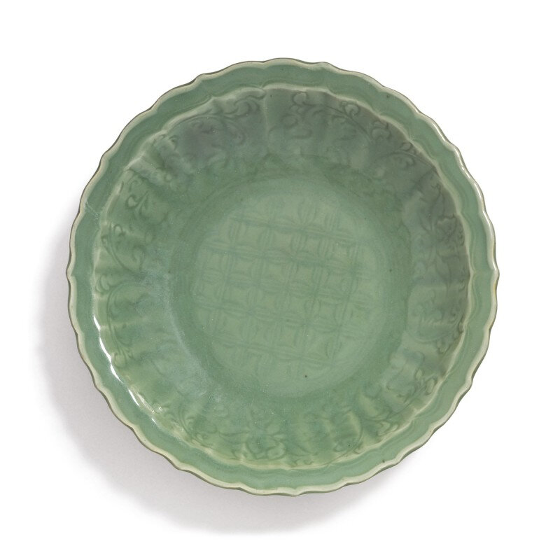 A 'Longquan' celadon-glazed 'Diaper and floral' barbed-rim charger, Ming dynasty (1368-1644)