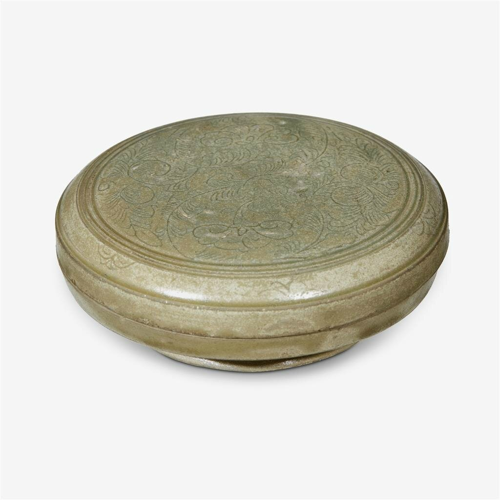 A Chinese 'Yue' celadon incised 'floral' box and cover, Five dynasties (907–960)