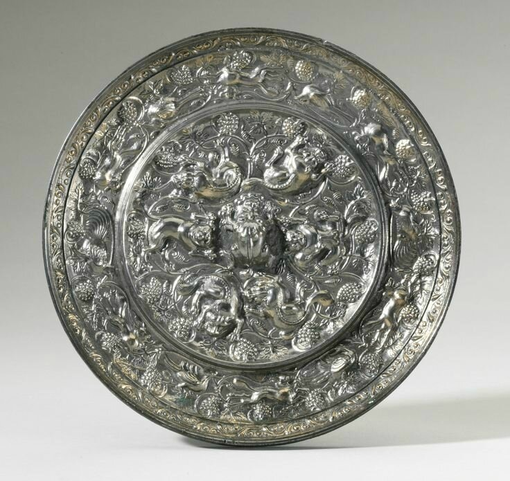 A bronze 'Sea Beasts and Grapes' mirror, Tang Dynasty