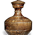 A rare amber-brown-glazed bottle and cover, liao dynasty, 10th century